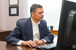 Dr. Pani at his desk.